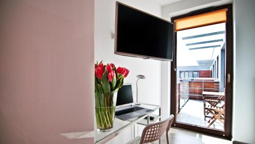 A television and/or entertainment center at Apartament Mateo