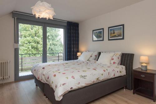 Een bed of bedden in een kamer bij Vakantiewoning Wielen