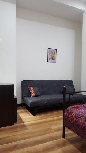 A seating area at Republic Square Metro Apartment