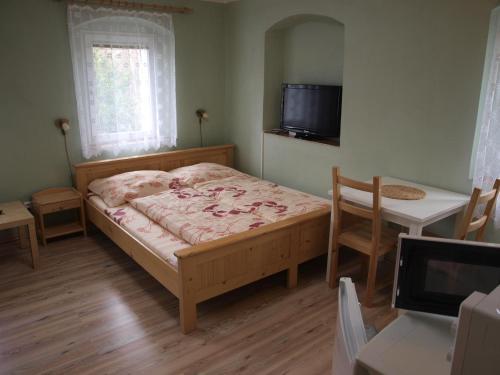 Ein Bett oder Betten in einem Zimmer der Unterkunft Apartments Viktoria Klinovec