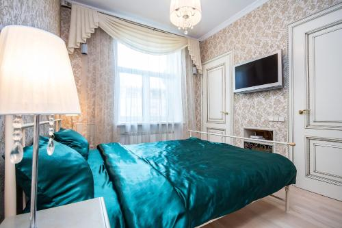 A bed or beds in a room at Vip Apartment In Minsk