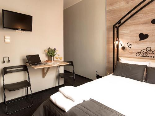 Кровать или кровати в номере Mish Mash Old Town