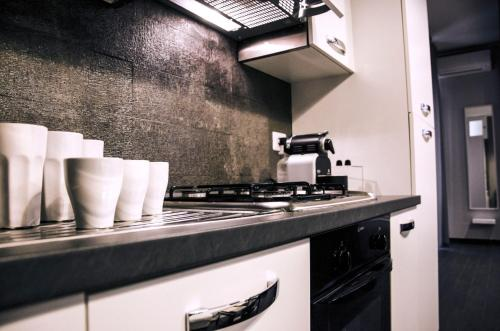 A kitchen or kitchenette at Only One Luxury Apartment