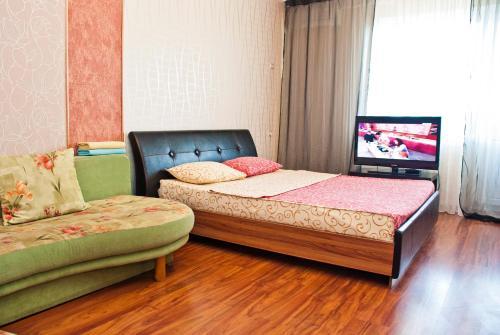 Кровать или кровати в номере Апартаменты Зиповская 5