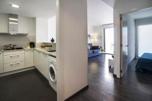 A kitchen or kitchenette at AB Parc Guell Luxury