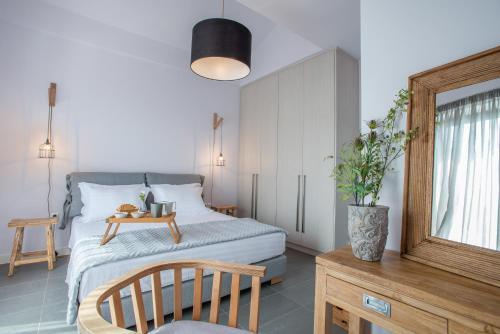 Ένα ή περισσότερα κρεβάτια σε δωμάτιο στο Melissi Villas