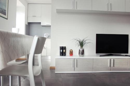 TV in/ali zabaviščno središče v nastanitvi Loft and Palma Apartments