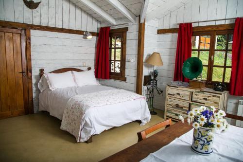 Una cama o camas en una habitación de Villa Constancia