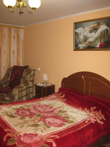 Кровать или кровати в номере Apartment Na Stroiteley 66