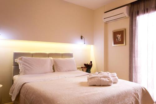 Ένα ή περισσότερα κρεβάτια σε δωμάτιο στο Leste Luxury Homes