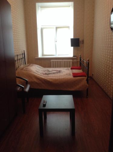 A bed or beds in a room at Hostel Volga
