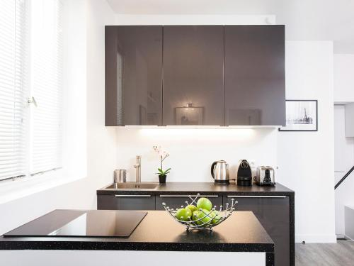 A kitchen or kitchenette at Charming apartment Paris center