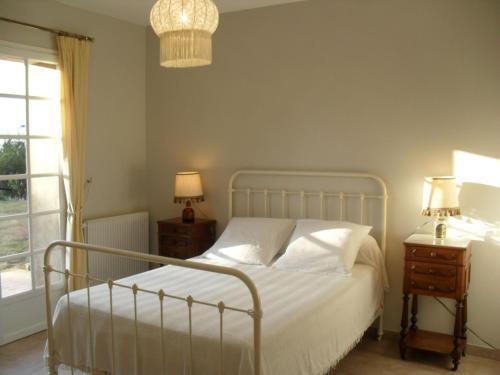 Un ou plusieurs lits dans un hébergement de l'établissement Villa Mas La Cigaliere
