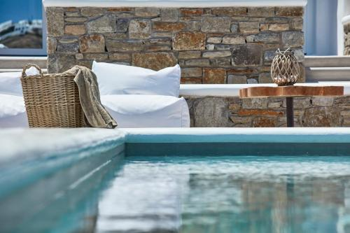 The swimming pool at or near Mykonos Waves Beach House & Suites
