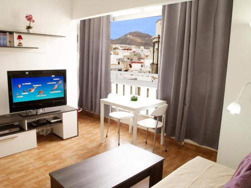 A television and/or entertainment centre at Brisas City LP