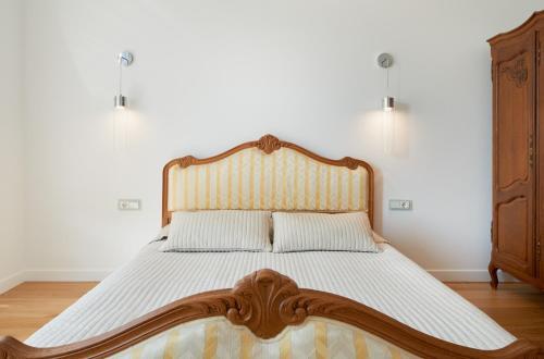 Gulta vai gultas numurā naktsmītnē Central Apartment