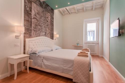 A bed or beds in a room at Boschetto 124 Apartment
