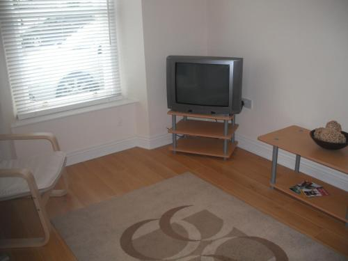 A television and/or entertainment center at The Blue House Apartments