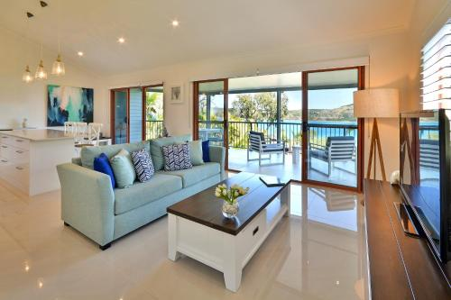 A seating area at Heliconia Grove on Hamilton Island
