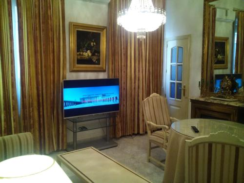 A television and/or entertainment center at Atocha Palace