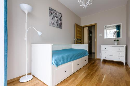 A bed or beds in a room at Apartment Wola4Mi