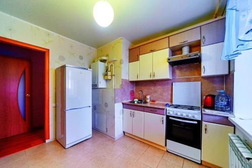 Кухня или мини-кухня в Apartment Petrova