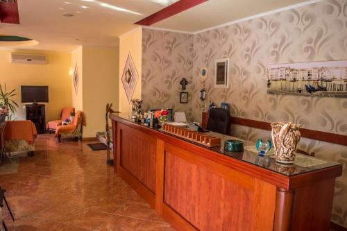 The lounge or bar area at Dolphins Apartments & Rooms