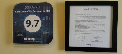 A certificate, award, sign, or other document on display at Casa Canela Vila Suzana - Centro