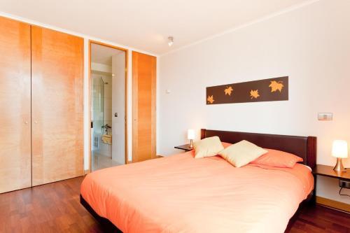 Cama o camas de una habitación en City Inn Apart Home