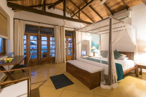 A bed or beds in a room at Kottukal Beach House by Jetwing