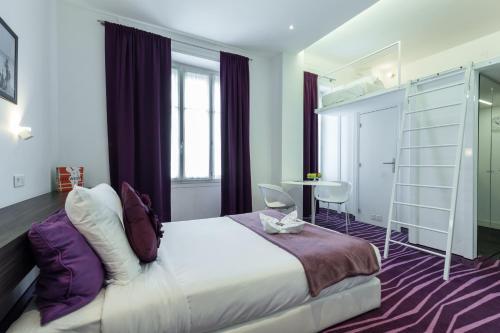 Un ou plusieurs lits dans un hébergement de l'établissement Nice Appart