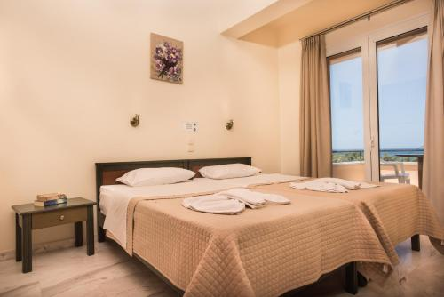 Camera di Mythos Beach Hotel Apartments