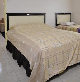 A bed or beds in a room at Silverstar Apartments @ Greenhill Resort