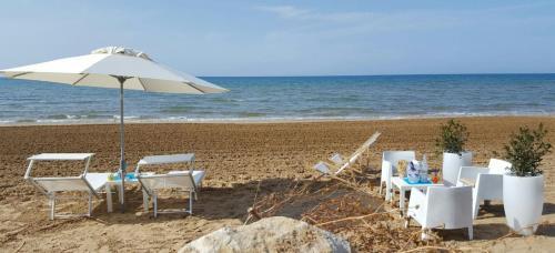 ห้องอาหารหรือที่รับประทานอาหารของ Caposud Residence and Beach Club