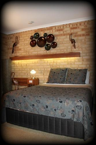 A bed or beds in a room at York's Boutique Motel