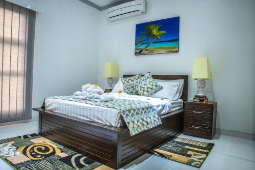 A bed or beds in a room at Island Charm Of Praslin