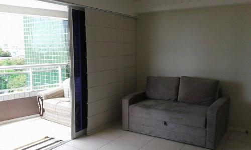 A seating area at Flat Studio Iracema