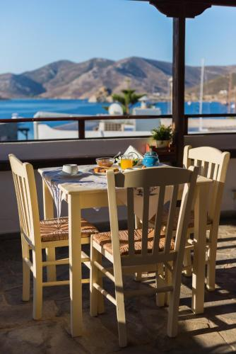A porch or other outdoor area at Grikos Hotel