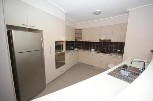 A kitchen or kitchenette at Castle Hill Self-Contained Modern Three-Bedroom Apartment (503 PEN)