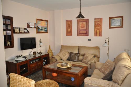 Ein Sitzbereich in der Unterkunft Casa del Laurel