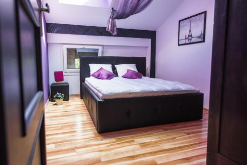 A bed or beds in a room at Old Town Krakow Apartments