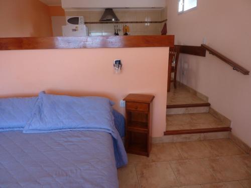 Una cama o camas en una habitación de Las Tunas