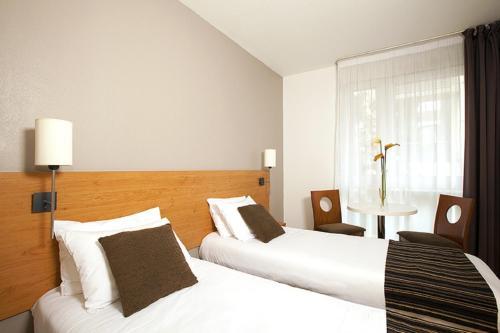 Un ou plusieurs lits dans un hébergement de l'établissement Séjours & Affaires Paris Ivry