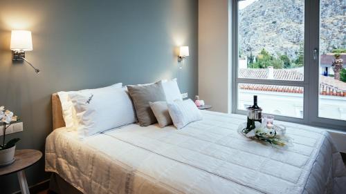 Ένα ή περισσότερα κρεβάτια σε δωμάτιο στο Filoxenion