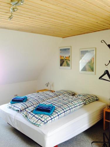 En eller flere senge i et værelse på Bønnerup Bed&Breakfast