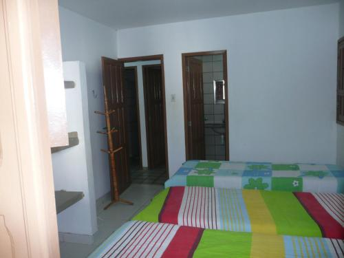 A bed or beds in a room at Privê Village Maragogi