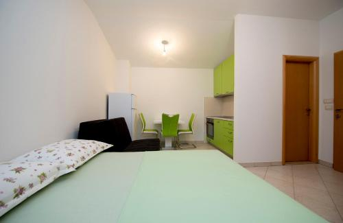 A bed or beds in a room at Studio Apartment Tesija