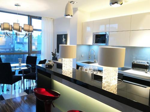 A kitchen or kitchenette at Luxury Apartments Mondrian Old Town