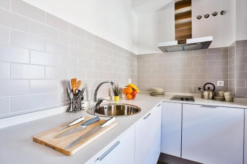 Küche/Küchenzeile in der Unterkunft Urban Vida Calatrava