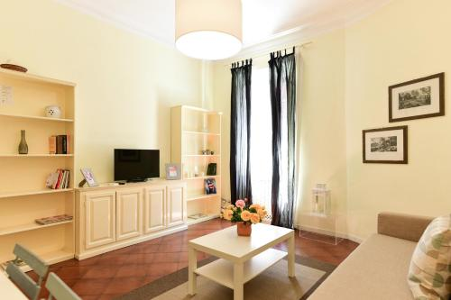 A television and/or entertainment center at Via Giulia Charming Apartment - Feels like Home